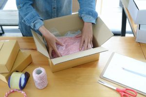 Online sellers are packing products into boxes for shipping to customers.